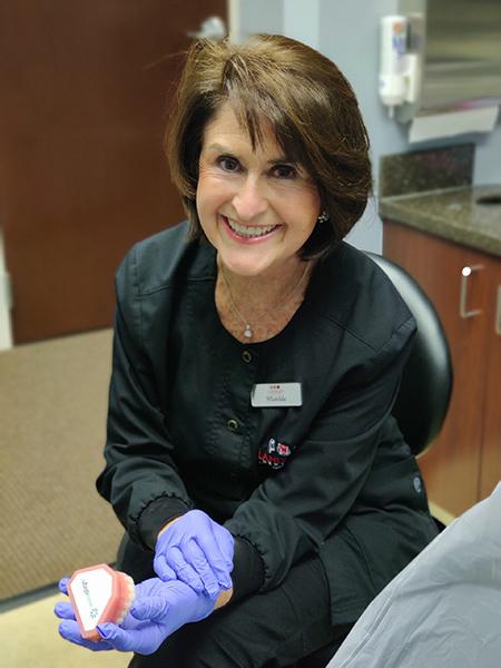 Our hygienist explains gum disease to our patient.